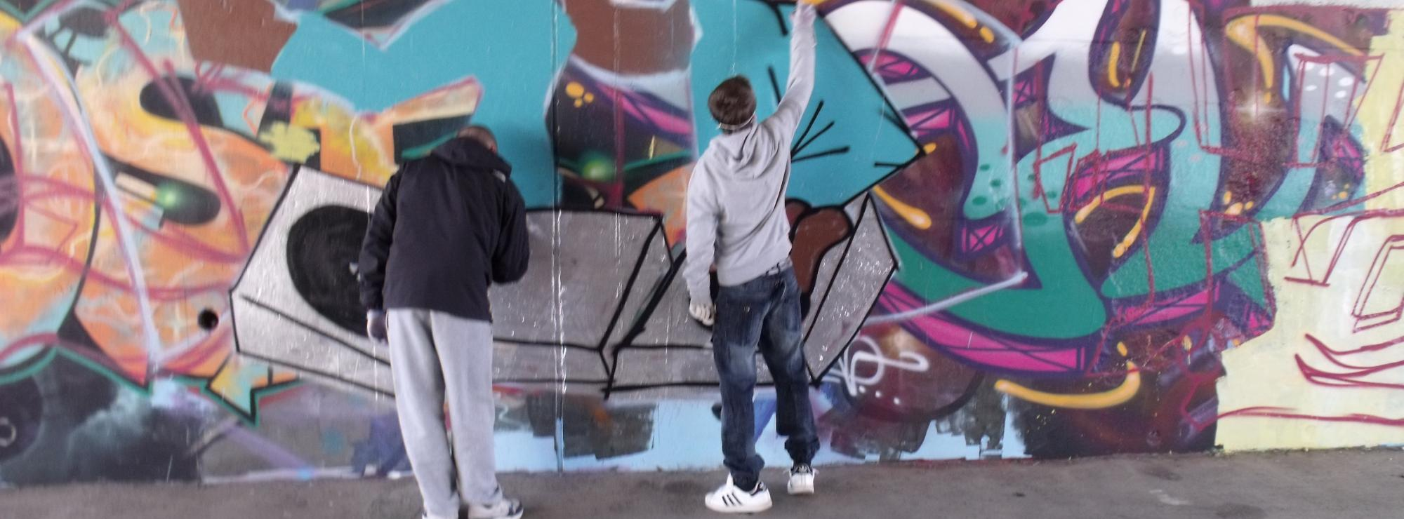 Young people creating urban art